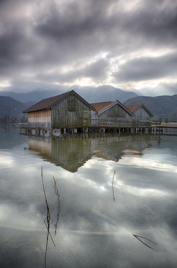 Kochel lake with huts stock photo