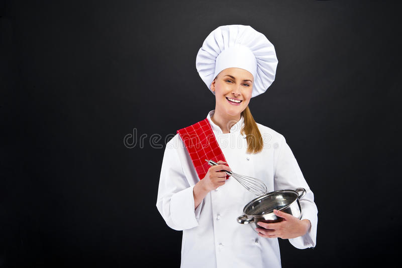 Kochen und Lebensmittelkonzept - lächelnder weiblicher Chefesprit lizenzfreie stockfotografie