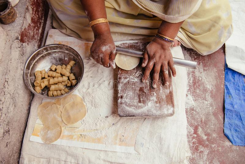 Cooking Indian street food poori in Kochi, Kerala. Kochi, India - December 11, 2015: Indian woman prepare traditional food on the street in Kerala. Delicious stock images