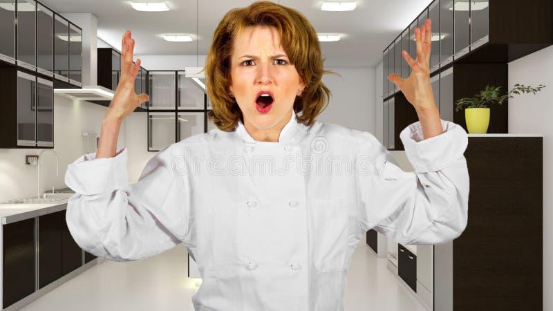 Kock i ett kök royaltyfria bilder