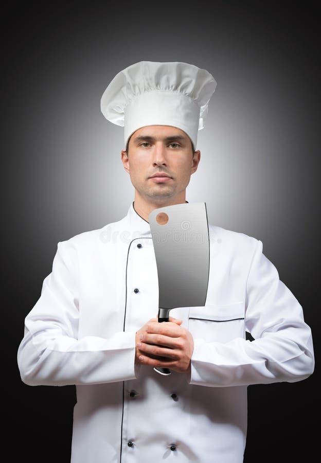 Kock med en köttyxa royaltyfria bilder