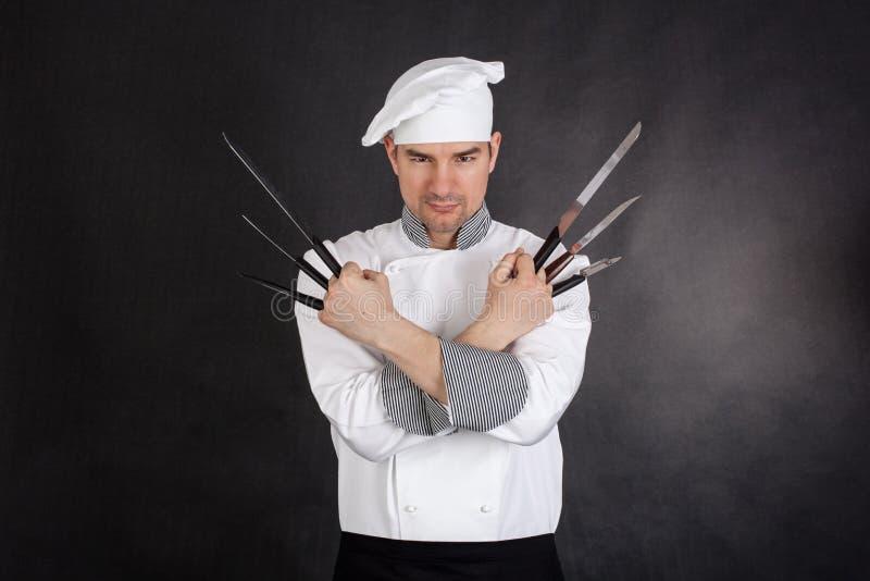 Kock med korsade knivarmar royaltyfria foton