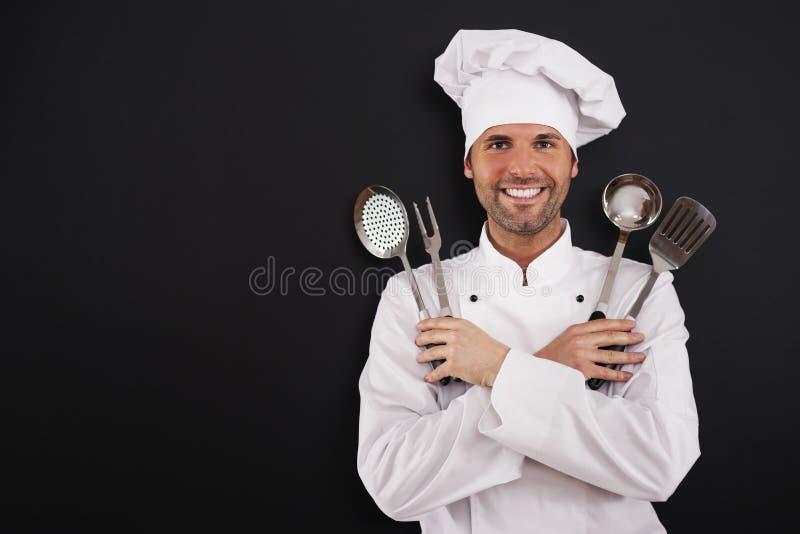 Kock med matlagningutrustning royaltyfri foto