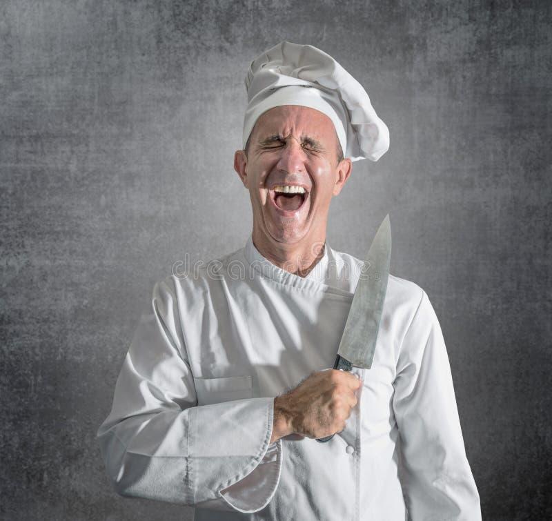 Kock som skrattar med en kniv i hand royaltyfri fotografi