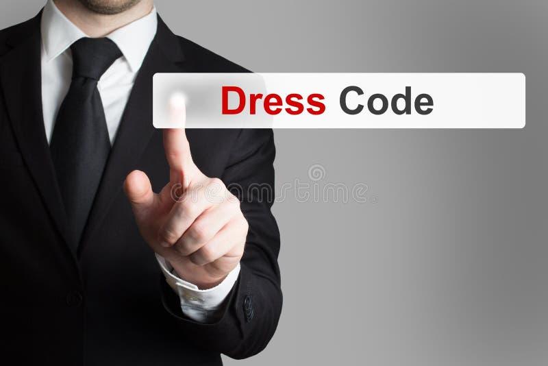 Kod för klänning för driftig knapp för affärsman arkivfoton