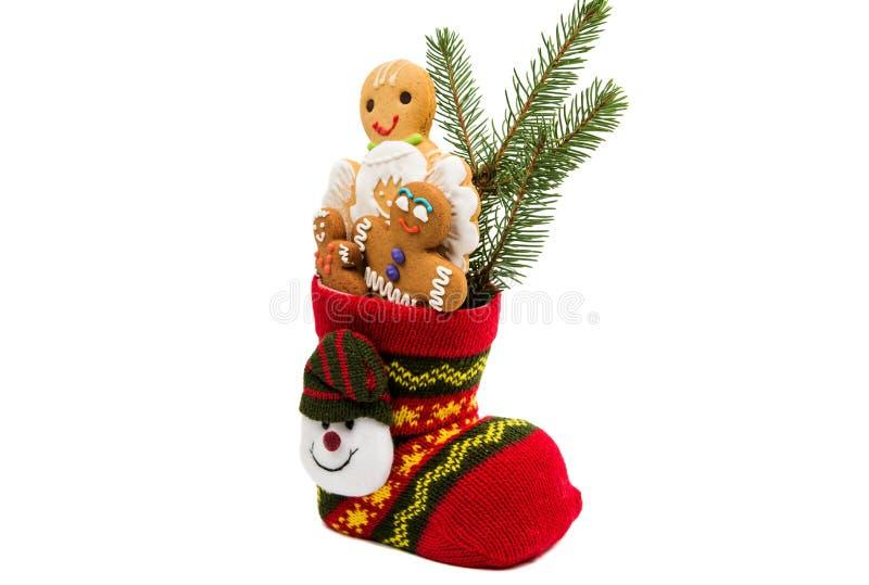 Koekjes in een geïsoleerde Kerstmissok stock fotografie