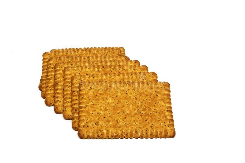 Koekjes op witte achtergrond worden geïsoleerd die Een koekje in een stapel bond met een kabel op een witte backgrou royalty-vrije stock afbeeldingen
