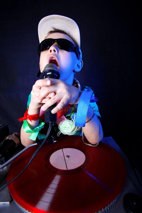 Koel jong geitje DJ stock foto