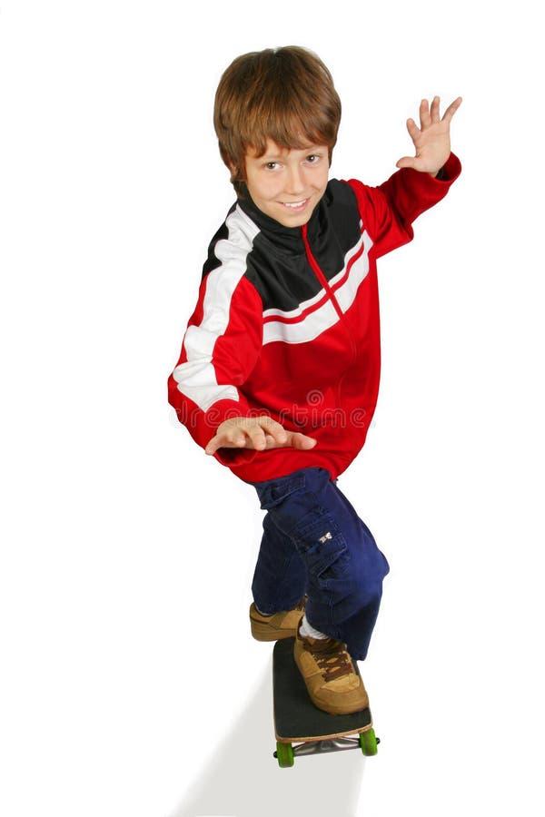 Koel jong geitje op skateboard royalty-vrije stock fotografie