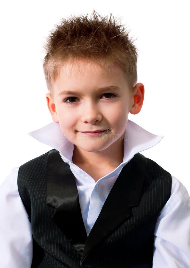 Koel weinig jongen in een vest stock foto's