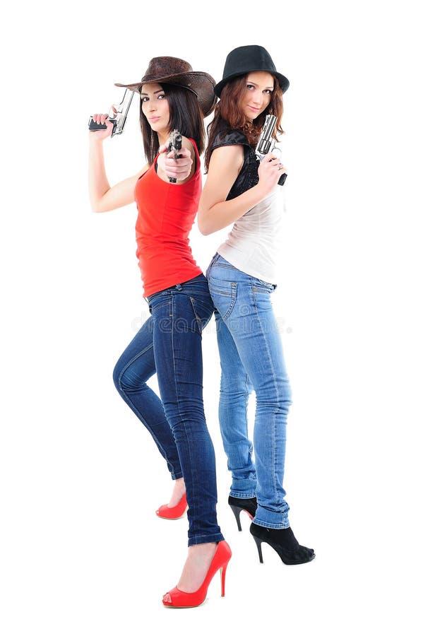 Koele meisjes met kanonnen stock foto's