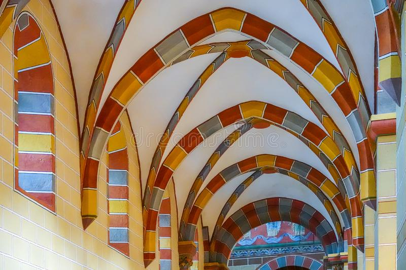 Colourful tiled arches and columns under the roof of the Imperial Cathedral of Königslutter stock photo