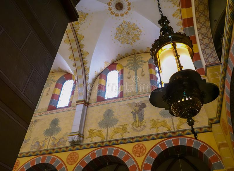 Wide-angle view from the inside of the cathedral of Königslutter with an artistic ceiling lamp and wall paintings stock images