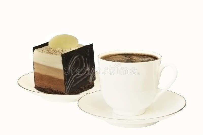 Koffie in een kop en een chocoladecake royalty-vrije stock afbeelding