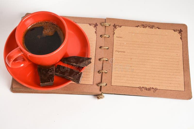 Koffie en notitieboekje stock fotografie