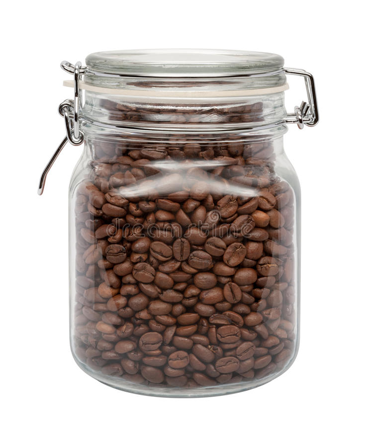 Koffiebonen in een glasbus stock afbeelding