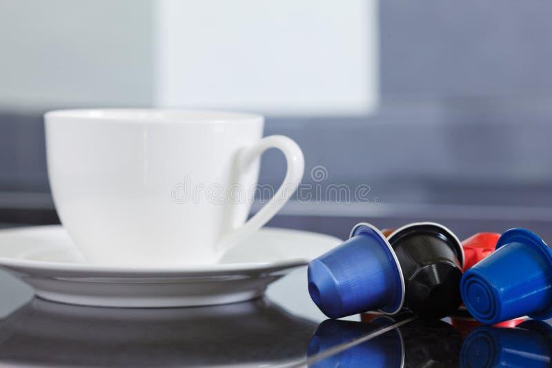 Koffiecapsules stock foto