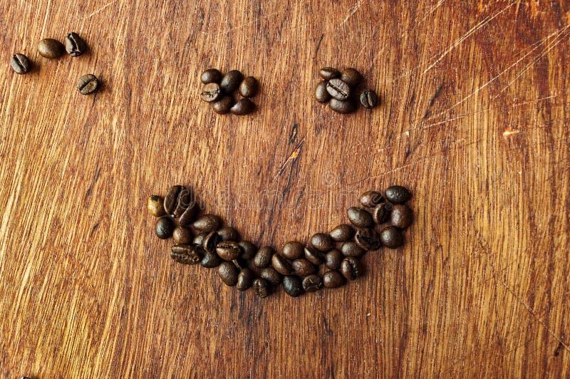 Koffieglimlach stock afbeeldingen