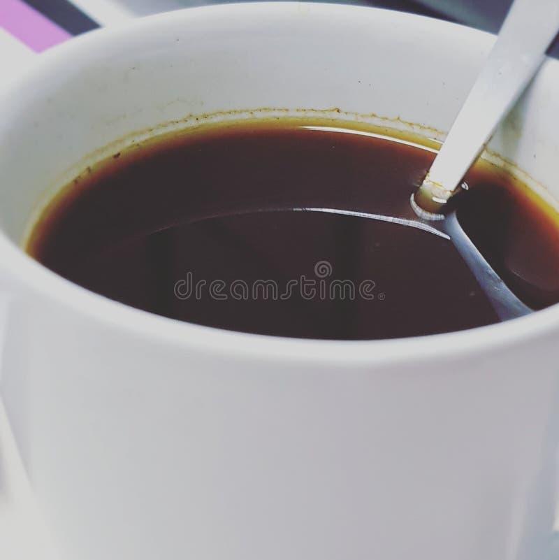 Koffiekop en koffiebonen royalty-vrije stock afbeelding