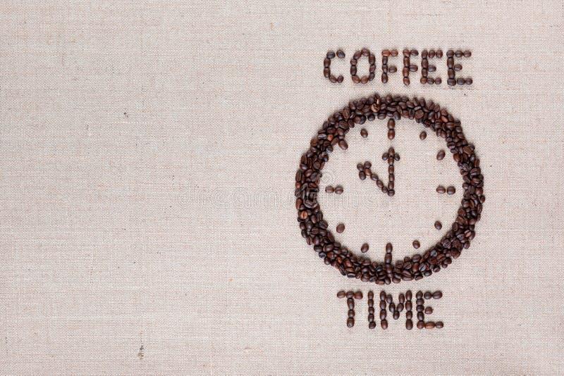 Koffieprikklok van koffiebonen, aan het recht wordt gemaakt dat stock fotografie