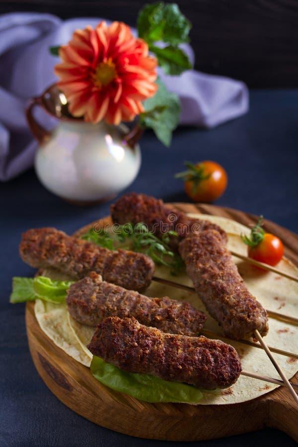 Kofta kebabs with pita bread, vegetables and yogurt sauce. royalty free stock photography