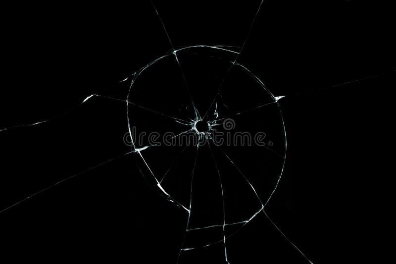 Kogelgat in glas dichte omhooggaand op zwarte achtergrond stock foto
