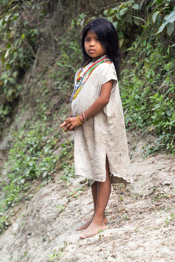 Kogi Indian Girl. MAGDALENA, COLOMBIA - FEBRUARY 3: Kogi Indian on February 3, 2014. The Kogi tribe inhabits the Sierra Nevada de Santa Marta mountain range near stock photo