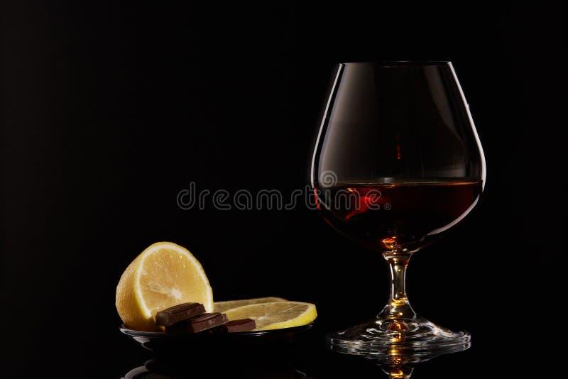 Kognak, Zitrone und Schokolade lizenzfreies stockbild