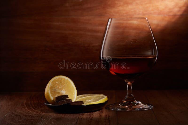 Kognak, Zitrone und Schokolade stockfoto