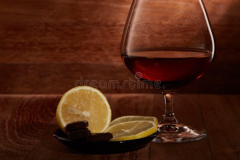 Kognak, Zitrone und Schokolade lizenzfreie stockfotos