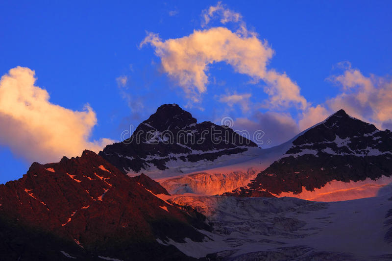 Download Kogutai Peaks stock photo. Image of ascent, cloud, altitude - 10796830