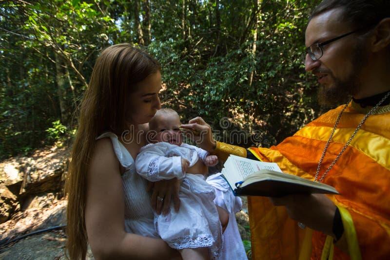 During Christian sacrament of spiritual birth - Baptism. KOH CHANG, THAILAND - MAR 10, 2018: During Baptism - Christian sacrament of spiritual birth. There are stock image