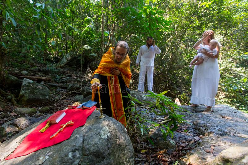 During Baptism - Christian sacrament of spiritual birth. KOH CHANG, THAILAND - MAR 10, 2018: During Baptism - Christian sacrament of spiritual birth. There are royalty free stock photography