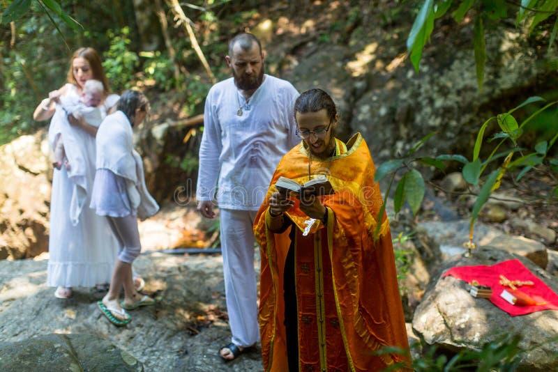 During Baptism - Christian sacrament of spiritual birth. KOH CHANG, THAILAND - MAR 10, 2018: During Baptism - Christian sacrament of spiritual birth. There are royalty free stock photos