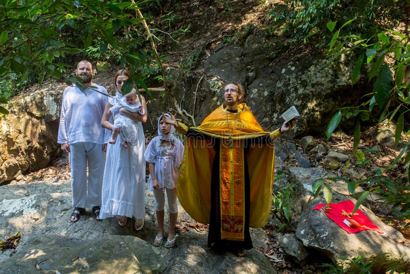 During Christian sacrament of spiritual birth - Baptism. KOH CHANG, THAILAND - MAR 10, 2018: During Baptism - Christian sacrament of spiritual birth. There are royalty free stock photography