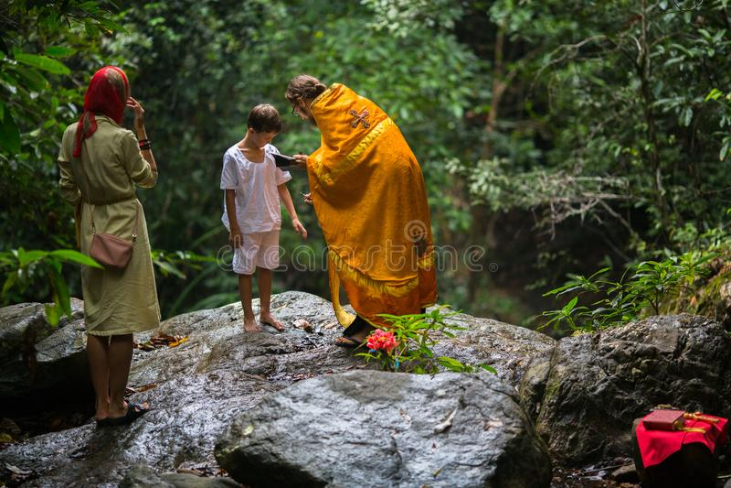 During Christian sacrament of spiritual birth - Baptism. KOH CHANG, THAILAND - MAR 9, 2018: During Christian sacrament of spiritual birth - Baptism. There are royalty free stock photography