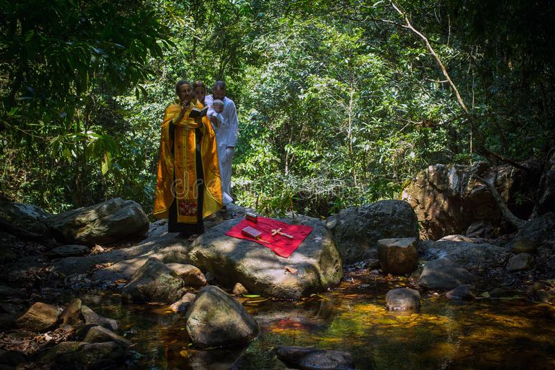 During Baptism - Christian sacrament of spiritual birth. KOH CHANG, THAILAND - MAR 10, 2018: During Christian sacrament of spiritual birth - Baptism. There are royalty free stock photo