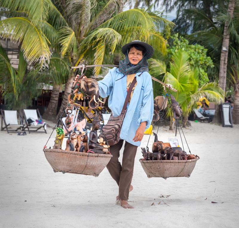 Koh Chang, THAILAND - MARCH 12: An elderly woman sells to tourists souvenirs on the beach, Thailand, on March 12, 2015. royalty free stock images