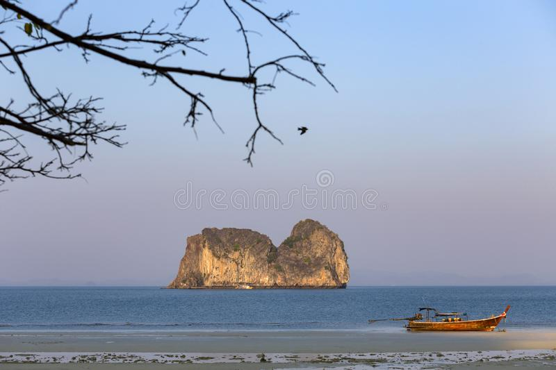 Koh ma hourse island and long tail boat at Koh Ngai island on the southern andaman coast. Trang province, Thailand stock image