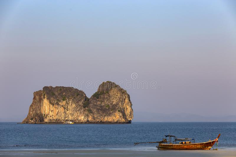 Koh ma hourse island and long tail boat at Koh Ngai island on the southern andaman coast. Trang province, Thailand royalty free stock image