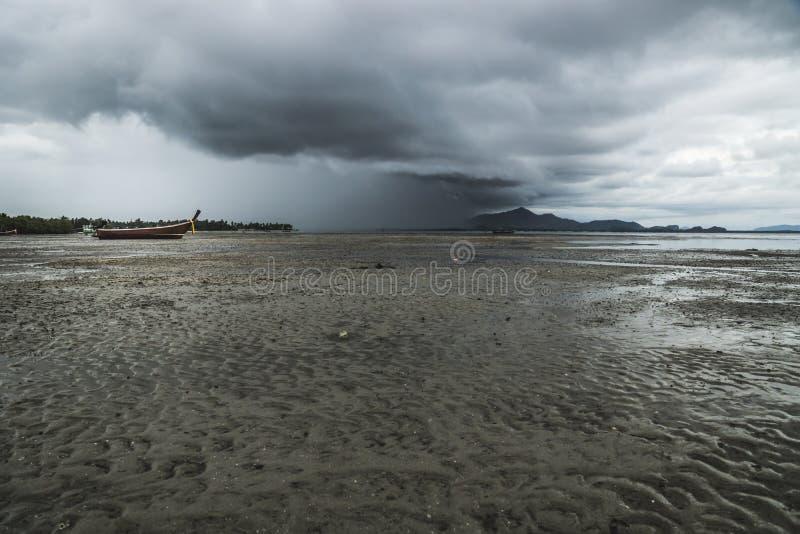 Koh Mook beach with rainclouds, Thailand. Koh Mook beach boat and with rainclouds, Thailand stock photography