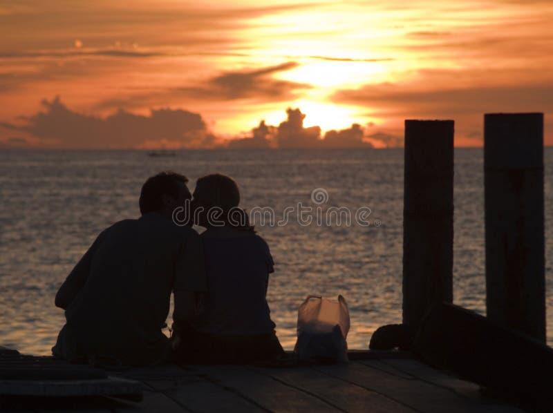Koh Tao Thailand. A couple kissing on a dock on Koh Tao Thailand royalty free stock photos