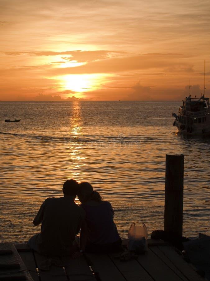 Koh Tao Thailand. A couple cuddling on a dock Koh Tao Thailand stock photo