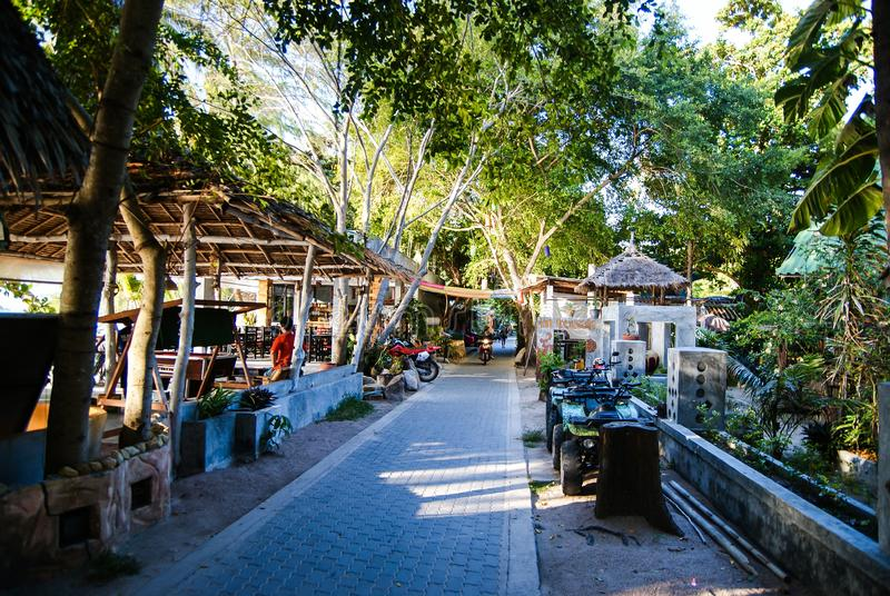 KOH TAO, THAILAND, Island life. A pedestrian street along the coast of Sayri beach is sometimes used by motorcycles.  royalty free stock image