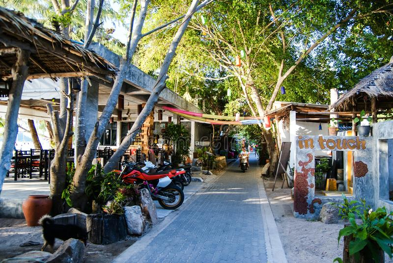 KOH TAO, THAILAND, Island life. A pedestrian street along the coast of Sayri beach is sometimes used by motorcycles.  stock photos