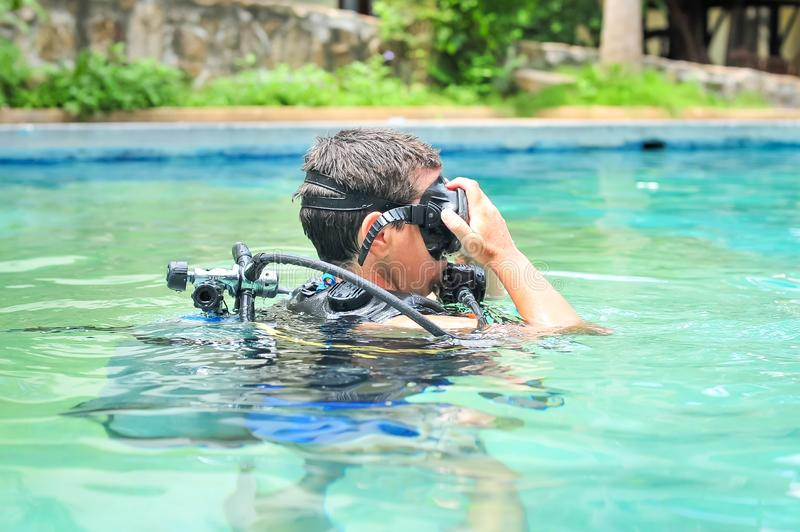 Scuba diving class in pool. Ban's diving resort-CDC center. KOH TAO, THAILAND - 26. MARCH 2018. Scuba diving class in pool. Open water course. Ban' stock photos