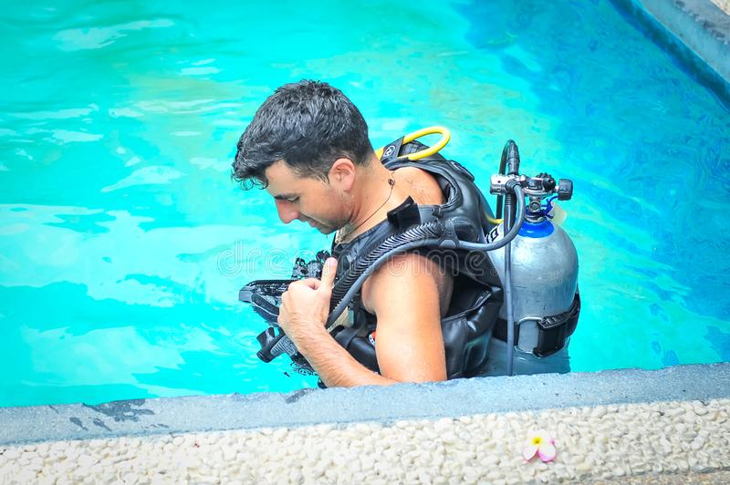 Scuba diving class in pool. Ban's diving resort-CDC center. KOH TAO, THAILAND - 26. MARCH 2018. Scuba diving class in pool. Open water course. Ban' stock image