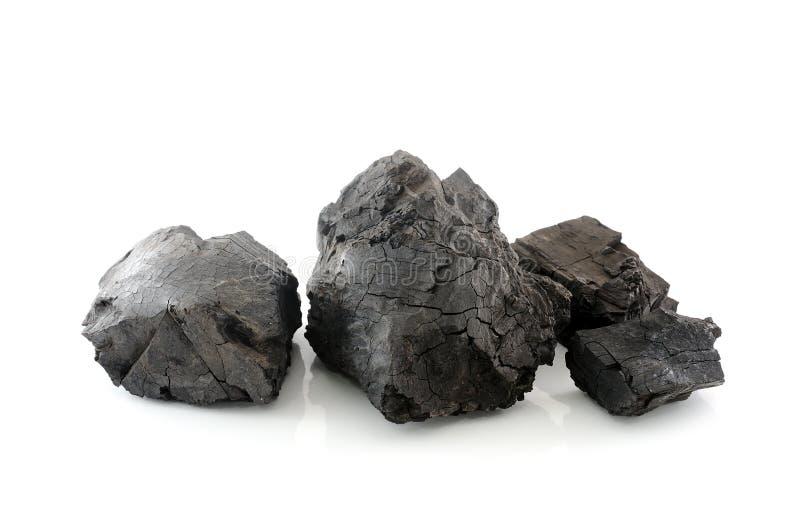 Kohle auf weißem Hintergrund lizenzfreie stockfotografie