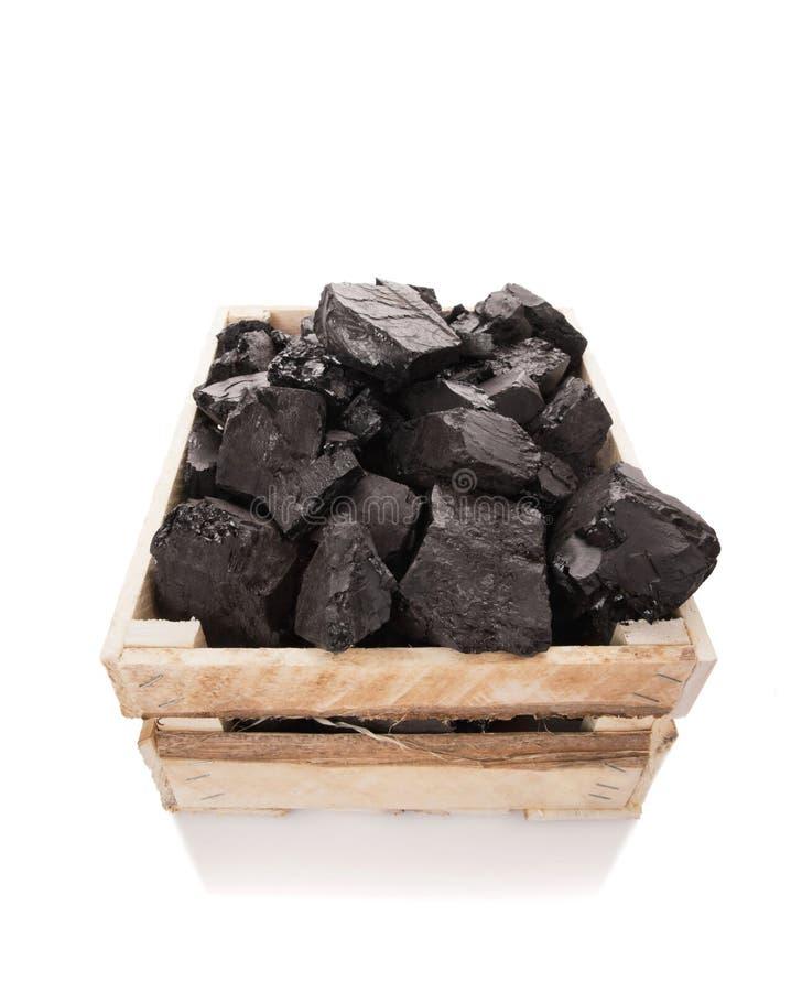 Kohle in einem hölzernen Kasten stockfoto