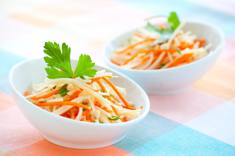 Kohlrabi and carrot salad. With pine nut,parsley and green onion stock photos